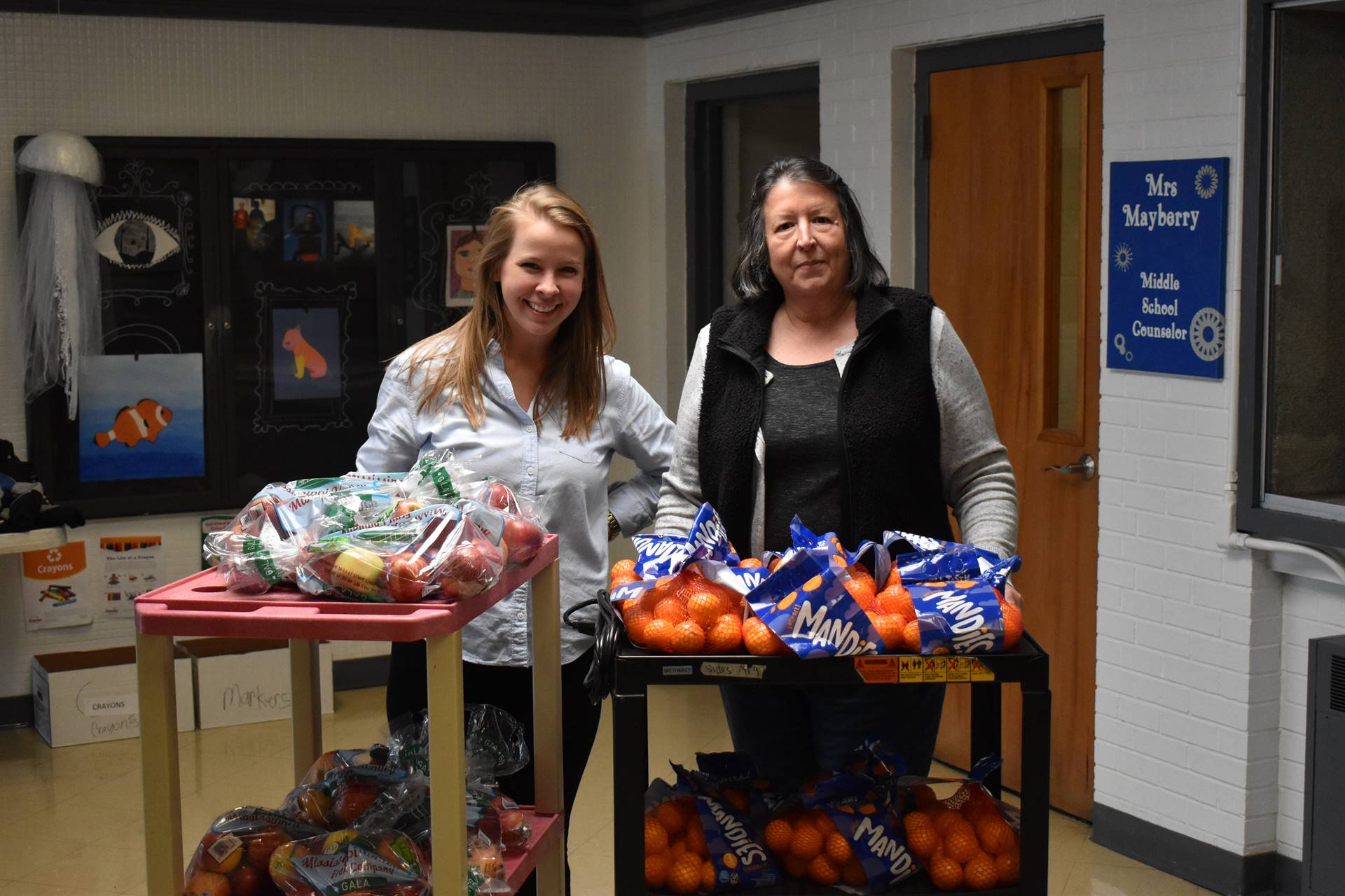 Benton Kiwanis Make Donation to Backpacks for Friday Program